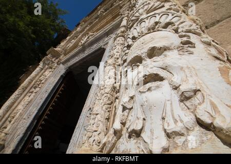 face sculpture and art relief on exterior facade of ancient building of Museum Santa Cruz, landmark and monument of the Sixteenth century in Toledo - Stock Photo