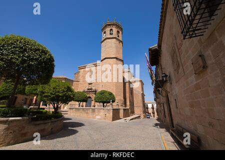 landmark street and bell tower of church of San Mateo or St Matthew, gothic and renaissance from Fifteenth century, in old town of Banos de la - Stock Photo