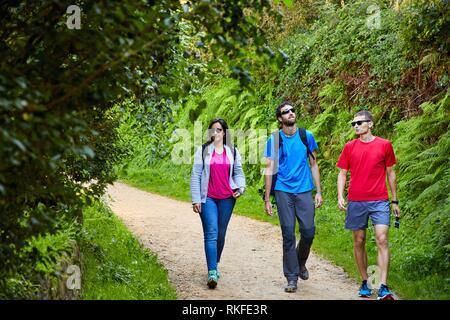 Group of tourists and guide making a tour of the Camino de Santiago, St. james Way, Pasaia, Donostia, San Sebastian, Gipuzkoa, Basque Country, Spain, - Stock Photo