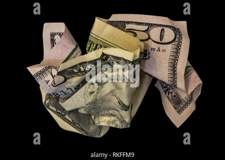 Crumpled fifty dollar bill isolated on black background - Stock Photo