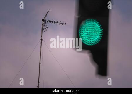 TV antenna and Traffic lights, Valencia, Spain - Stock Photo