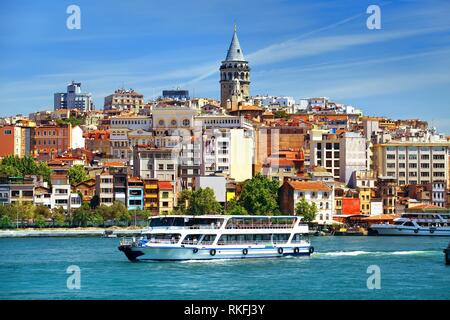 Cityscape of Istanbul with the view on Galata Tower and boats in Golden Horn bay, Turkey. - Stock Photo