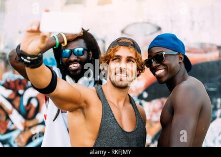 Friends Taking a Selfie During a Rest After a Street Basketball Game. - Stock Photo