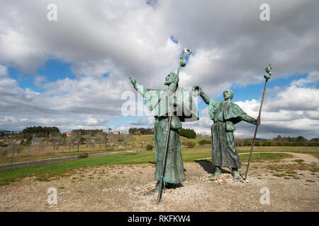 Statues of Pilgrims looking at the cathedral on Monte do Gozo in Santiago de Compostela, Spain. Way of St. James, pilgrimage - Stock Photo