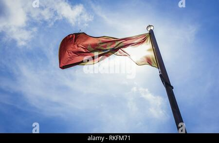 Montenegrin flag in Citadel on the Old Town of Budva city on the Adriatic Sea coast in Montenegro. - Stock Photo