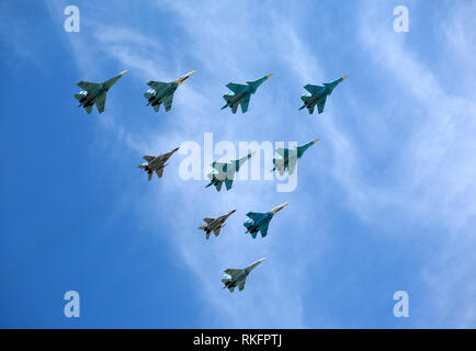 Russian military aircraft fighters SU-27 and MIG-29in flight against blue sky on May 9, 2015 in Moscow - Stock Photo