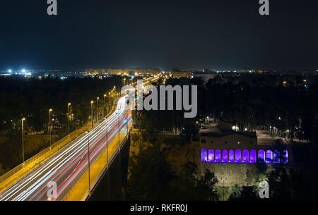 View of the Avenue of Railway and the Real Mill at night in the city of Elche. Long exposure with horizontal framing. - Stock Photo