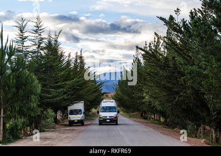 Automobile on the highway with a beautiful sky in Cusco. - Stock Photo