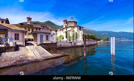 View from the pier of Cannobio to the Santuario della Santissima Pietà at Lake Maggiore Maggiore - Lago Maggiore, Verbania, Piemont, Italy. - Stock Photo
