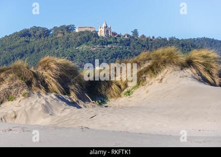 Sanctuary of Santa Luzia seen from Cabedelo Beach (Praia do Cabedelo) in Viana do Castelo city in Norte region of Portugal. - Stock Photo