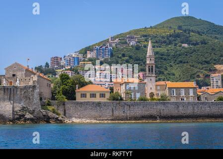 View from sea on the Old Town and bell tower of John the Baptist cathedral in Budva city on the Adriatic Sea coast, Montenegro. - Stock Photo