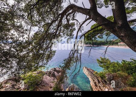 View from Milocer rocks on a Queenâ.s Beach in front of Villa Milocer Aman Sveti Stefan luxury hotel in Przno, Montenegro. - Stock Photo