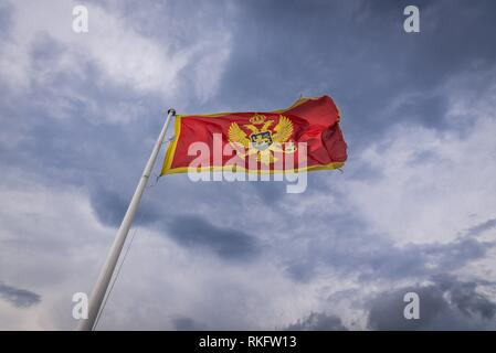 Montenegrin flag on Forte Mare fortress in Herceg Novi city on the Adriatic Sea coast in Montenegro. - Stock Photo