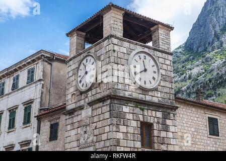 Clock Tower dates from 1602 on the Square of Arms of Old Town in Kotor coastal city, located in Bay of Kotor of Adriatic Sea, Montenegro. - Stock Photo