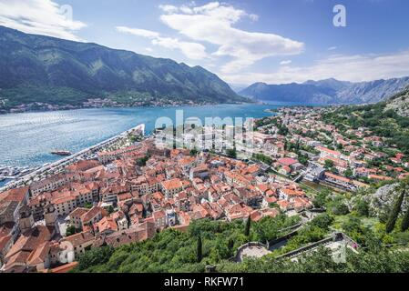 Kotor coastal city, located in Bay of Kotor of Adriatic Sea, Montenegro. Dobrota town on background. - Stock Photo