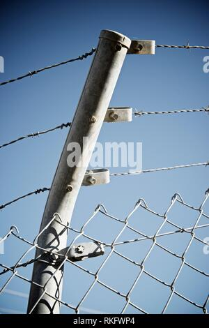 Barbed wire fence view in Spain. - Stock Photo