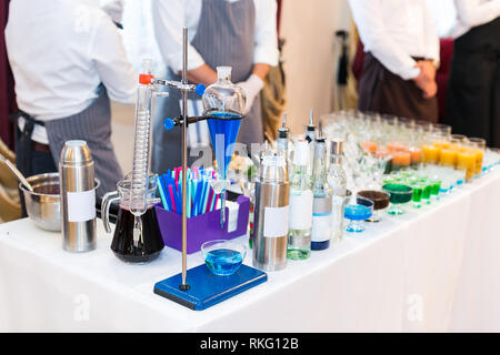 set of test-tubes and various chemical devices for preparations of molecular cocktails. Multi-colored alcoholic molecular beverages for a party. - Stock Photo