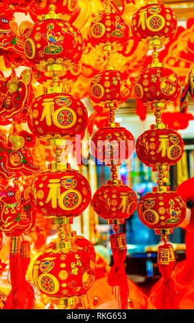 Red Chinese Lunar Lanterns New Year Decorations Beijing China. Decorations hung by many Chinese as decorations. Chinese charactes are not trademarks - Stock Photo