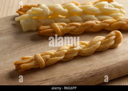 Traditional handmade Slovakian smoked and unsmoked korbacik string Cheese. - Stock Photo