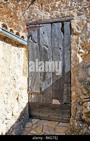 Rustic wood door in Mallorca, Balearic islands, Spain. - Stock Photo