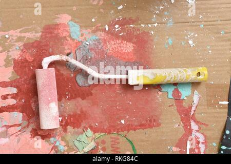 blobs of paint after painting a wall,roller paint. - Stock Photo