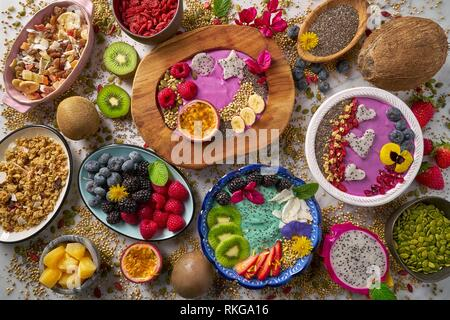 Acai bowl smoothie and Spirulina algae with chia berries and fruits healthy food. - Stock Photo