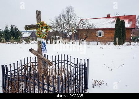 Old wayside cross in Soce village on so called The Land of Open Shutters trail, famous for traditional architecture in Podlaskie Voivodeship, Poland. - Stock Photo