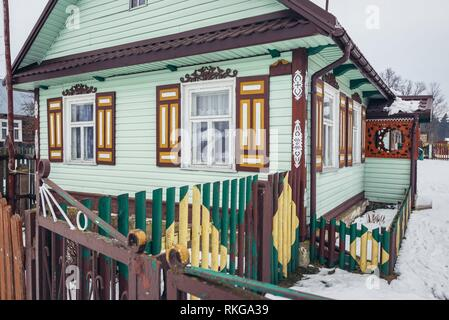 Decorated house in Soce village on so called The Land of Open Shutters trail, famous for traditional architecture in Podlaskie Voivodeship, Poland. - Stock Photo