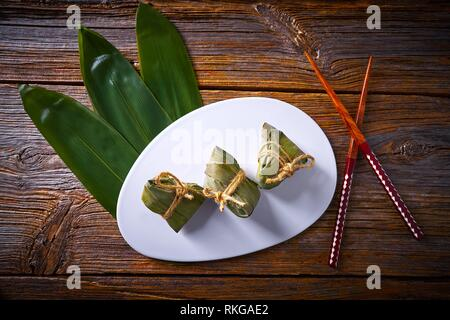 Zongzi Glutinous sticky Rice Dumplings recipe wrap with bamboo leaves asian food. - Stock Photo