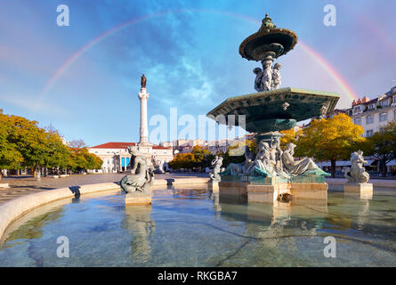 Rainbow over Rossio square in Lisbon Portugal - Stock Photo