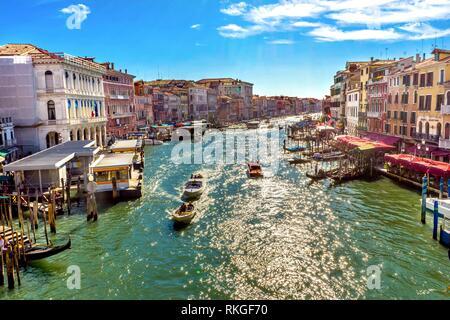 Colorful Grand Canal Public Ferries Vaporetto Ferry Docks Gondolas From Rialto Bridge Touirists Grand Canal Venice Italy. - Stock Photo