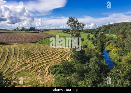View from destroyed railway bridge over Sapina river in Kruklanki village, Gizycko County in Warmian-Masurian Voivodeship of Poland. - Stock Photo