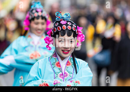 © Chris Bull. 10/2/19  MANCHESTER , UK.   The Chinese New Year is celebrated in Manchester today (Sunday 10th Feb 2019).  The annual dragon parade from took place from Albert Square to Chinatown for the Chinese year of the pig. Dancers and musicians joined two large dragons as the parade made it's way through huge crowds in the city centre.    Photo credit: CHRIS BULL - Stock Photo