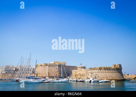 The harbour and the old walls of Gallipoli, Puglia Region - South Italy. - Stock Photo