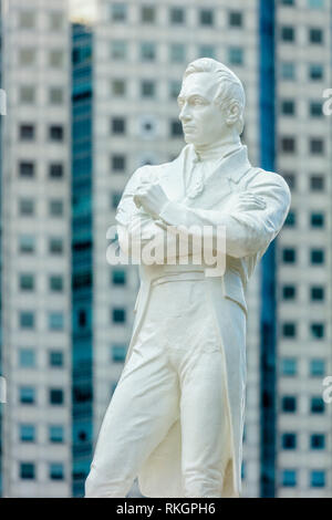 Singapore bicentennial Sir Stamford Raffles statue close up at Boat Quay Raffles Place during day time - Stock Photo