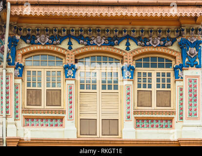 Singapore Little India conservation district, transitional Art Deco shophouse near Jalan Besar, zoom in close up details of architectural facade - Stock Photo