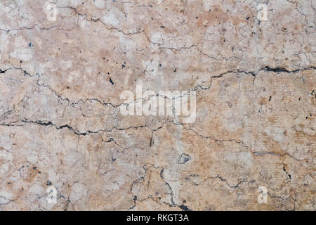 Detailed beige cracked  stone surface, texture of old natural marble - Stock Photo