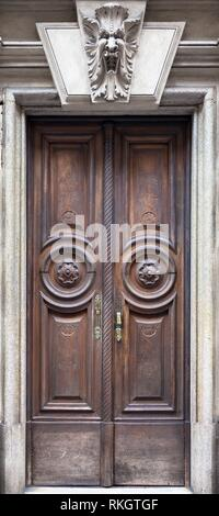 Italy, Turin. This city is famous to be a corner of two global magical triangles. This old door has been guarded by a gargoyle in last hundred years. - Stock Photo