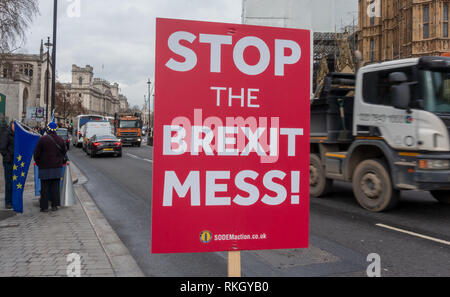 Remain placard saying 'Stop the Brexit Mess' outside British Parliament in London - Stock Photo