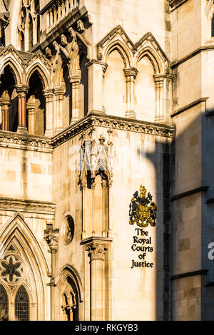 Winter sun on a detail at the Royal Courts of Justice, The Strand, London, UK - Stock Photo