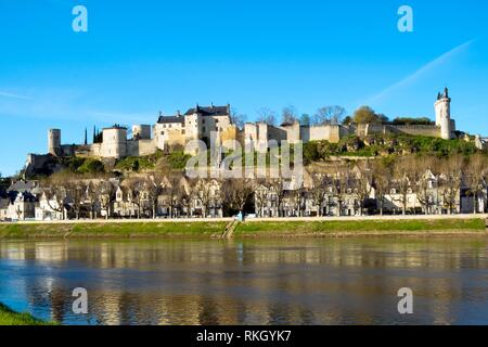 Chinon town with its chateau on the hill above in spring afternoon sunshine on the banks of the River Vienne, Indre-et-Loire, France. - Stock Photo