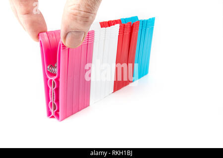 Colorful clothes  pegs made of plastic in  a row - Stock Photo
