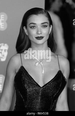 London, UK, February 10th, 2019.  ( Image digitally altered to monochrome ) Amy Jackson attends the 72nd British Academy Film Awards at the Royal Albert Hall - Stock Photo