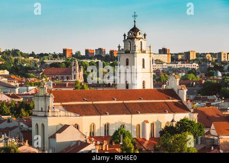 Sunset Sunrise Cityscape Of Vilnius, Lithuania In Summer. Beautiful View Of Old Town In Evening. Sts Johns' Church (Sv. Jonu baznycia). - Stock Photo