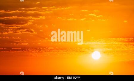 Panorama of Beautiful Natural Sunset Sunrise. Panoramic Background. Warm yellow and orange colors. - Stock Photo