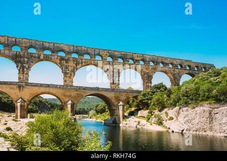 Famous landmark Ancient old Double arches of the Roman aqueduct of Pont du Gard, Nimes, France. - Stock Photo