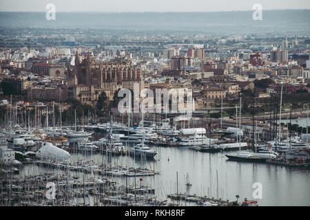 The city Palma de Mallorca with port and Majorca Cathedral from a birds eye view. Panoramic view from the top, winter morning - Stock Photo