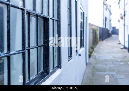 Narrow back street passages and terraced houses and cottages. Whitby, North Yorkshire. UK - Stock Photo