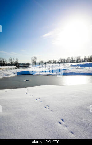 Datteln, Ruhr area, North Rhine-Westphalia, Germany - Sunny winter landscape, renatured Lippe floodplains, the Lippe in winter with ice and snow, new  - Stock Photo