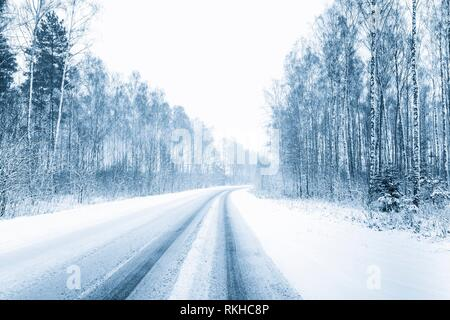Snow-covered Open Road During A Snowstorm In Winter. Adverse Weather Conditions. Toned Filtered Photo. - Stock Photo